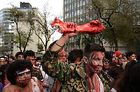 D.F. Mexico, November 23. 2013. A man carries a bone while Thousands of people dressed as zombies take part in a march from the plaza of the three cultures on the Paseo de la Reforma Avenue to the Angel of Independence.  VIEWpress/Miguel Angel Pantaleon