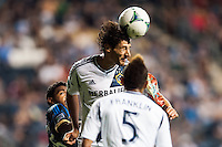 Omar Gonzalez (4) of the Los Angeles Galaxy heads the ball. The Los Angeles Galaxy defeated the Philadelphia Union 4-1 during a Major League Soccer (MLS) match at PPL Park in Chester, PA, on May 15, 2013.
