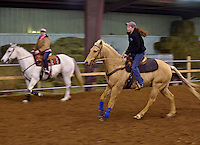 NWA Democrat-Gazette/BEN GOFF -- 02/01/15 Brittney Doshier, 17, of Colcord, Okla. lopes her horse around the arena during a break from drills as the Rodeo of the Ozarks Rounders hold practice in Isuba Valley Horse Park near Siloam Springs on Sunday, Feb. 1, 2015.
