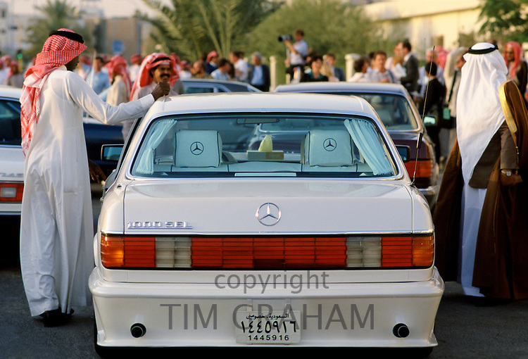 1000SEL top of the range Mercedes limousine and chauffeur takes wealthy arab man to the racecourse in Riyadh, Saudi Arabia