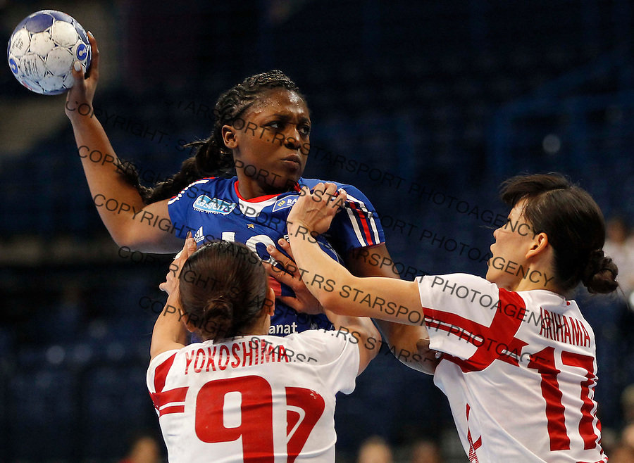 BELGRADE, SERBIA - DECEMBER 15:   Audrey Doreen (C) of France in action against  Yuko Arihama (R) and  Kaoru Yokoshima (L) of Japan during the 2013 World Women's Handball Championship 2013 match between France and Japan at Kombank Arena Hall on December 15, 2013 in Belgrade, Serbia. (Photo by Srdjan Stevanovic/Getty Images)