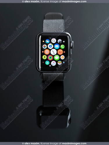Apple Watch smartwatch with app icons on display front view isolated on black background