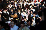 Kimono-clad 20-year-old Japanese women and men walk make their way to an event to mark Coming-of-Age Day in Tokyo, Japan on Monday Jan. 11, 2009. Japanese enter adulthood at 20, when they can legally smoke, drink alcohol and vote, though debate is heating up as to whether or not the age should be lowered to 18 in line with many advanced countries. Indeed, the Japanese government plans to lower the voting age to 18 as of mid-2010.   .Photographer: Robert GilhoolyCOMING OF AGE
