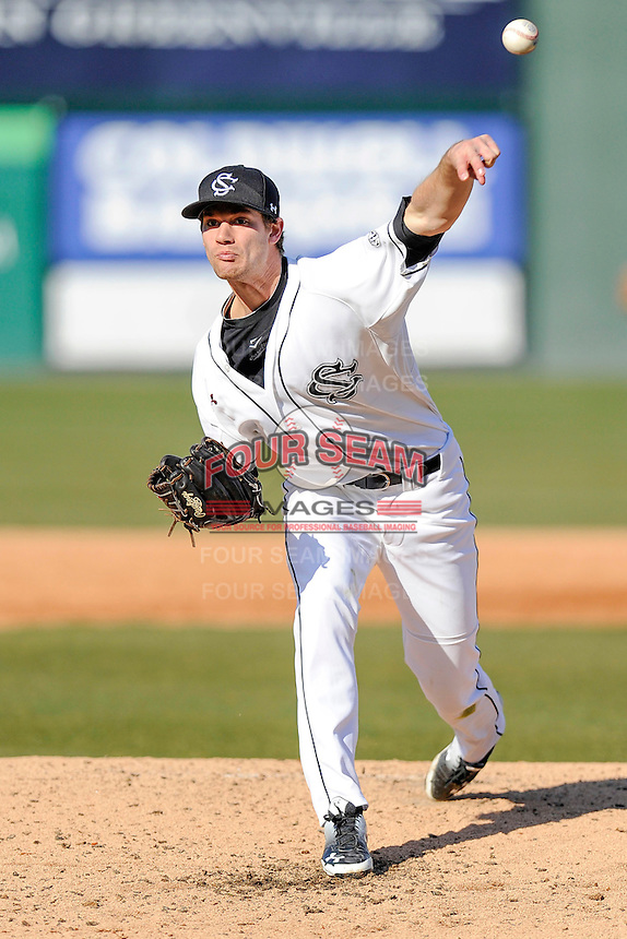Winning pitcher Jack Wynkoop (13) of the South Carolina Gamecocks delivers a pitch in the Reedy River Rivalry game against the Clemson Tigers on Saturday, February 28, 2015, at Fluor Field at the West End in Greenville, South Carolina. South Carolina won, 4-1. (Tom Priddy/Four Seam Images)