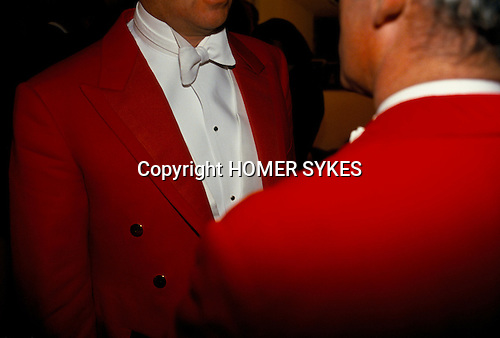 'WARWICKSHIRE HUNT BALL', MEN WEARING TRADITIONAL WHITE TIE &amp; RED TAIL COAT DINNER OUTFITS TALKING TOGETHER