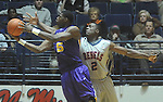 "Louisiana State's Malcolm White (5) shoots as Ole MIss forward Reginald Buckner (2)  defends at the C.M. ""Tad"" Smith Coliseum in Oxford, Miss. on Wednesday, February 9, 2011. Ole Miss won 66-60 and is now 4-5 in the Southeastern Conference."