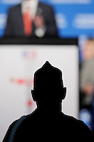 A veteran is silhouetted against the stage at the Veterans of Foreign Wars national convention, Tuesday, Aug. 30, 2011, in San Antonio. (Darren Abate/pressphotointl.com)