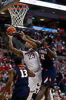Ohio State Buckeyes center Amir Williams (23) shoots for two against Illinois Fighting Illini guard Tracy Abrams (13) and Illinois Fighting Illini forward/center Nnanna Egwu (32)  n the first half at Value City Arena in Columbus Jan. 23, 2013 (Dispatch photo by Eric Albrecht)