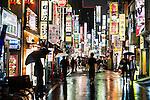_SAM7216; Shinjuku Kabuki-cho, Tokyo; Japan; 2008; JAPAN-10134. People walk through the wet streets of Tokyo.<br /> <br /> Tokyo in the Rain<br /> <br /> Retouched_Sonny Fabbri 11/14/2013