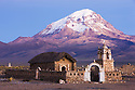 Bolivia, Altiplano, old Andean church with Nevado Sajama in background; dawn