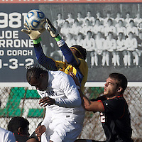 University of Connecticut goalkeeper Andre Blake (18) grabs high cross.University of Connecticut forward Allando Matheson (8) and .NCAA Tournament. University of Connecticut (white) defeated Northeastern University (black), 1-0, at Morrone Stadium at University of Connecticut on November 18, 2012.