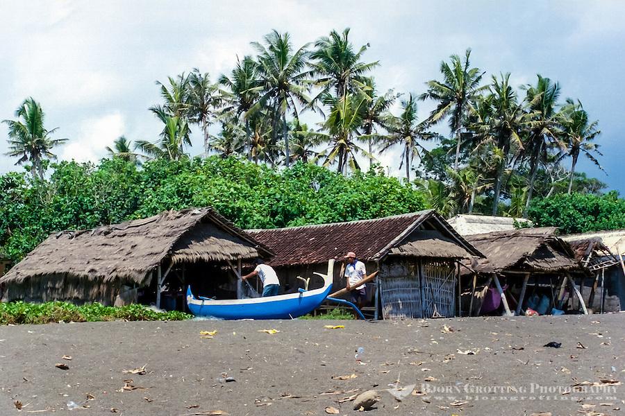 Bali, Badung, Seseh. Fishermen preparing for the nights fishing on Seseh beach.