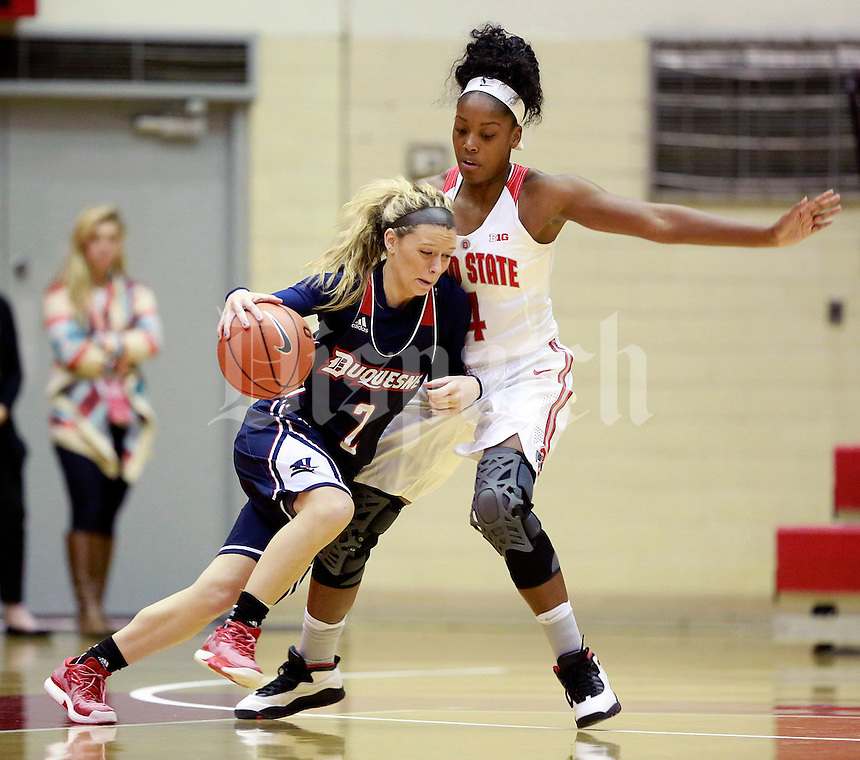Chassidy Omogrosso (2) of the Duquesne Lady Dukes is guarded by Sierra Calhoun (4) of the Ohio State Buckeyes during the Buckeyes' home opener at St. John Arena on Friday, November 11, 2016. Ohio State won the game 89-69. (Barbara J. Perenic/The Columbus Dispatch)