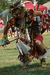 Dance Contest Men's Traditional at Native American Pow Wow. Close up of Native American wearing Pow Wow Regalia. Examples of ethnic pride, heritage, competition, celebration, and traditional    folk art crafts