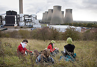 Climate activists take a break on a day of direct action against the coal fired power station at Ratcliffe on Soar, south of Nottingham. The power station, owned by E.ON, is the third largest emitter of greenhouse gases in the UK.