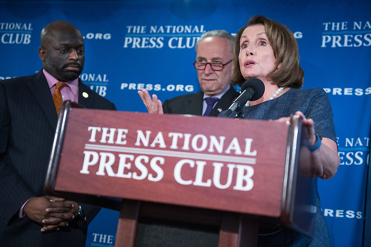 UNITED STATES - FEBRUARY 27: House Minority Leader Nancy Pelosi, D-Calif., and Senate Minority Leader Charles Schumer, D-N.Y., center, deliver a prebuttal at the National Press Club to tomorrow's address to a joint session of Congress by President Donald Trump, February 27, 2017. National Press Club President Jeff Ballou appears at left. (Photo By Tom Williams/CQ Roll Call)