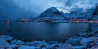 Twilight over bay at Å I Lofoten, the end of the E10, Moskenesøy, Lofoten Islands, Norway