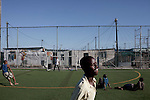 Khayelitsha, South Africa March 5, 2013: Under 14 years boys practice football on the grounds of Amandla EduFootball program. It was founded by Jakob Schlichtig, Florian Zech outside the field in Khayelitsha a poor township outside Cape Town, South Africa. They use football to initiate, support educational projects for youth in the township. The program keep children busy and it decreases the risk of them joining gang, criminal activity or teenage pregnancy. The crime level has decreased substantially in the area since the program was created in 2006. (Photo by: Per-Anders Pettersson)
