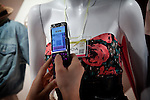 (Eng) Yokohama, March 6 2010 - At the Tokyo Girls Collection, models and TV stars are parading for fast-fashion brands in front of 20 000 teenagers. In a boot inside the stadium. Yuka, 23, taking a picture with her mobile phone of a &quot;virtual tag&quot; (bar code) that will redirect her to the outfit page on the brand web site.<br /> <br /> (Fr)Yokohama, 6 mars 2010 - A la Tokyo Girl Collection, des mannequins et stars de la television defilent pour des marques grand-public devant 20 000 adolescentes. Sur un stand dans l'enceinte de l'evenement,Yuka, 23 ans, photographie avec son telephone portable un &quot;virtual tag&quot; (code barre), lui permettant d'acceder directement au modele correspondant sur le site internet de la marque.