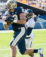 Pitt tight end Scott Orndoff scores on a 37-yard touchdown catch despite the efforts of Virginia safety Quin Blanding. The Pitt Panthers football team defeated the Virginia Cavaliers 26-19 on Saturday October 10, 2015 at Heinz Field, Pittsburgh, Pennsylvania.