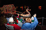 A decorated boat passes by clapping residents at the Holiday Around the World Celebration in Sun City, Az  at the Lakeview Recreation Center December 10, 2010...2010 marks the 50th anniversary of Sun City, America's first retirement city that remains the largest today with more than 40,000 residents 55 and older.