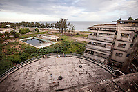 A view over the Indian Ocean from the rooftop of the former Grand Hotel. Once a luxury destination for the wealthy and the continent's biggest hotel, the building is now a concrete shell and home to about 6,000 squatters. Those unable to occupy one of the rooms sleep in the corridors, basements and even on the roof of the building.