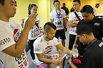 Dae Hwan Kim, Kamma Bantam weight champion, getting hands bandaged in locker room before fight<br />