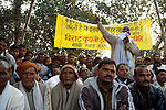 Hundreds of men crowd together in a village field outside Varanasi for a local tournament. A commentator announces the contestants as well as honored guests - former champion wrestlers. The ancient tradition of Indian wrestling, known as  kushti, thrives in Varanasi, one of the world's oldest cities. Wrestling gyms, or akhara, scattered around the city are of the few places where Hindu men from different casts are considered equals. Aside from bodybuilding, practiioners emphasize a life of discipline and celibacy. But as modernity sweeps India and Western sports like cricket become more popular, some akhara are being abandoned. While some prominent, government-run gyms switched to mats for Olympic-style wrestling, akhara in villages and towns maintain the old ways.