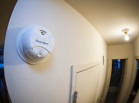 A 10 year smoke dectectors with a non-removable battery on the wall of an apartment in New York on Wednesday, December 30, 2015. NYS Gov. Andrew Cuomo has signed into law a bill requiring all smoke detectors have non-removable batteries by January 1, 2017. The older models are prone to people pulling out the batteries to prevent cooking from setting off the alarm. (© Richard B. Levine)