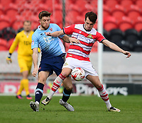 Doncaster Rovers' John Marquis shields the ball from Blackpool's Will Aimson<br /> <br /> Photographer Chris Vaughan/CameraSport<br /> <br /> The EFL Sky Bet League Two - Doncaster Rovers v Blackpool - Keepmoat Stadium - Doncaster<br /> <br /> World Copyright &copy; 2017 CameraSport. All rights reserved. 43 Linden Ave. Countesthorpe. Leicester. England. LE8 5PG - Tel: +44 (0) 116 277 4147 - admin@camerasport.com - www.camerasport.com
