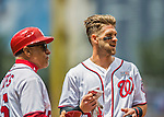 15 May 2016: Washington Nationals outfielder Bryce Harper chats with first base coach Davey Lopes during a game against the Miami Marlins at Nationals Park in Washington, DC. The Marlins defeated the Nationals 5-1 in the final game of their 4-game series.  Mandatory Credit: Ed Wolfstein Photo *** RAW (NEF) Image File Available ***