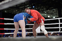Moscow, Russia, 05/06/2010..Ivan Kosov and Achmed Mysaev struggle during a Sambo bout, part of the new Fight Nights boxing tournament.