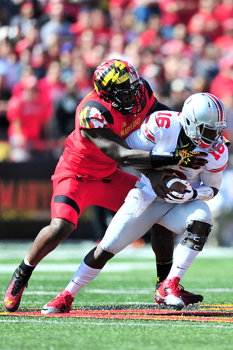 Buckeyes' QB J.T. Barrett is sacked. Ohio State trounced Maryland 52-24 during a game at the Capital One Field in Byrd Stadium, College Park, MD on Saturday, October 3, 2014.  Alan P. Santos/DC Sports Box