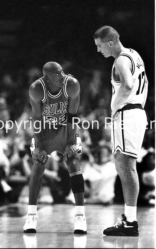 Chicago Bull's Michael Jordan witrh Golden State Warrior Chris Mullen. (photo by Ron Riesterer/photoshelter)