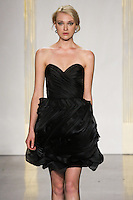 Model walks runway in a black mikado organza dress, strapless weetheart neckline, draped bodice and full textured skirt bridesmaid dress by Lazaro Perez, from the Noir by Lazaro Spring 2012 Bridal fashion show.