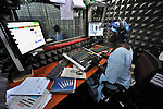 """Melania Itto, the program manager of Radio Bakhita, hosts the morning """"Juba Sunrise"""" program in the station's studio in Juba, the capital of Southern Sudan. NOTE: In July 2011 Southern Sudan became the independent country of South Sudan."""