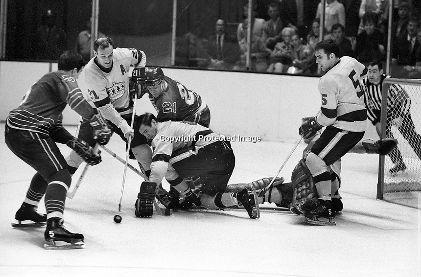 Seals vs LA Kings 1969 play-off game. Seals Carol Vadnais and Bob Dillabough. for the Kings Bill White and Brent Hughes.  (photo by Ron Riesterer)