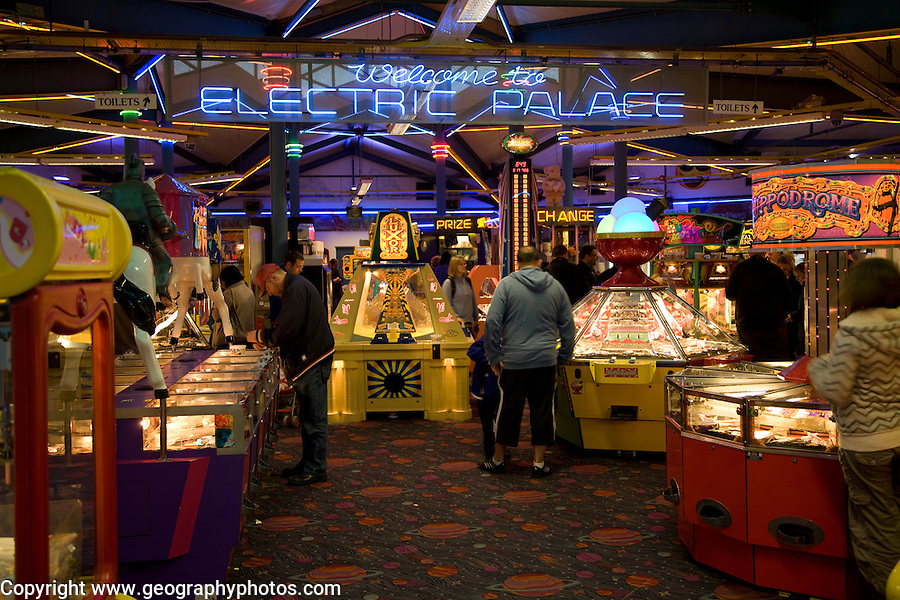 People playing on machines, Electric Palace amusement ...