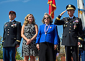 United States Army 1st Lt. Stephen Petraeus, Anne Petraeus, Holly Petraeus, and U.S. Army General David H. Petraeus observe the marching of the Joint Service Color Guard at the retirement ceremony and Armed Forces Farewell for Petreaus, Joint Base Meyer-Henderson Hall, Va., August 31, 2011. Petraeus is retiring after a 37-year career to become the director of the Central Intelligence Agency. On Friday, November 9, 2012, David H. Petraeus, the director of the Central Intelligence Agency, resigned on  after issuing a statement saying that he had engaged in an extramarital affair..Credit: Chad J. McNeeley / DoD via CNP
