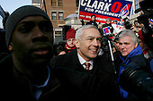 Manchester, New Hampshire.USA.January 26, 2004..Democratic presidential hopeful General Wesley Clark attends a rally at City Halll Plaza as he campaigns during the day of the primary..