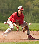 BEACON FALLS,  CT-051817JS30-Wolcott's Alex James (30) tries to field a ground ball during their game against Woodland Thursday at Woodland Regional High School in Beacon Falls. The ball took a bad hop and skipped past James. <br /> Jim Shannon Republican-American