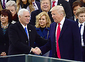 United States President Donald J. Trump and US Vice President Mike Pence shake hands after the inaugural ceremony on the West Front of the US Capitol on Friday, January 20, 2017.<br /> Credit: Ron Sachs / CNP<br /> (RESTRICTION: NO New York or New Jersey Newspapers or newspapers within a 75 mile radius of New York City)