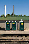 Three green plastic outhouses at the Nevada Northern Railway Yards..