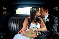 Newlyweds Claudia and Daniel share an intimate moment in their Rolls Royce following their wedding ceremony in Seattle. (Photo by Dan DeLong/Red Box Pictures)