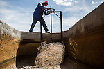 LA MESA, NM - APRIL 10, 2015:  Margarito Novello opens an irrigation gate near a partially collapsed well on Archer's farm. Archer will have to replace the well soon, one of two on his farm. CREDIT: Max Whittaker for The New York Times