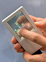 May 30, 2012, Tokyo, Japan - A futuristic smartphone, of which touch panel is operable from its front and back side, is shown at the NTTs booth on the opening day of the Wireless Japan 2012, Japans biggest showcase of wireless and mobile technologies and solutions, in Tokyo on Wednesday, May 30, 2012. Some 180 companies participated in the three-day event, which the organizer expected to draw more than 50,000 visitors. (Photo by Natsuki Sakai/AFLO) AYF -mis-