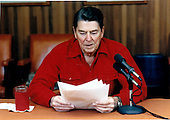 United States President Ronald Reagan makes his weekly radio address from Camp David, Maryland on Saturday, December 6, 1986.Mandatory Credit: Pete Souza - White House via CNP