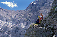 CANADA, ALBERTA, KANANASKIS, MAY 2002. A hiker prepares to scramble down the rocks on the Ribbon Falls trail.  The Kananaskis Country provincial park is home to Canada's most beautiful nature and wildlife. It has also escaped the mass tourism as in Banff National Park. Photo by Frits Meyst/Adventure4ever.com