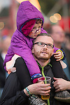 Electric Fields music festival at Drumlanrig Castle near Dumfries Scotland, father with daughter on his shoulders enjoying the music