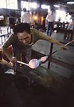 An artisan shapes a glass bowl with the help of man made tools  at the Hokuyo Glass Manufacturing Company's Blown Glass Factory in Aomori, Japan. Glass blowers at the factory churn out between 1,500 and 2,000 pieces of glass daily. (Jim Bryant Photo.....